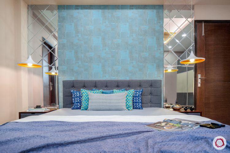 master-bedroom-blue-wall-mirror-panel-light-fixture-bed