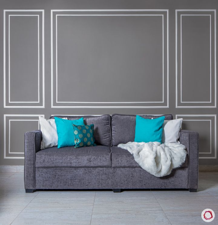 paint or wallpaper indian walls-grey sofa-blue and white cushions