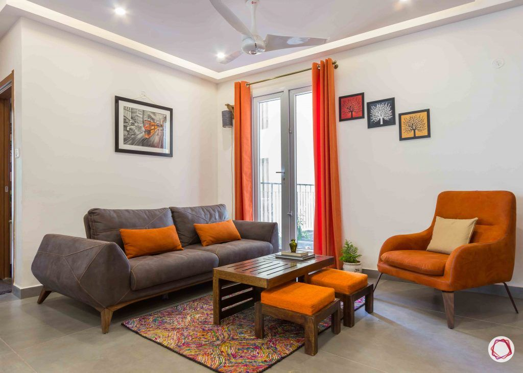 Best interior designers in bangalore_orange-armchair-pillows-sofa