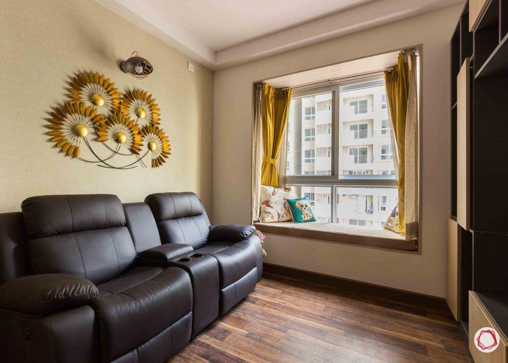 Best interior designers in bangalore_entertainment room-black-sofas-window-seat