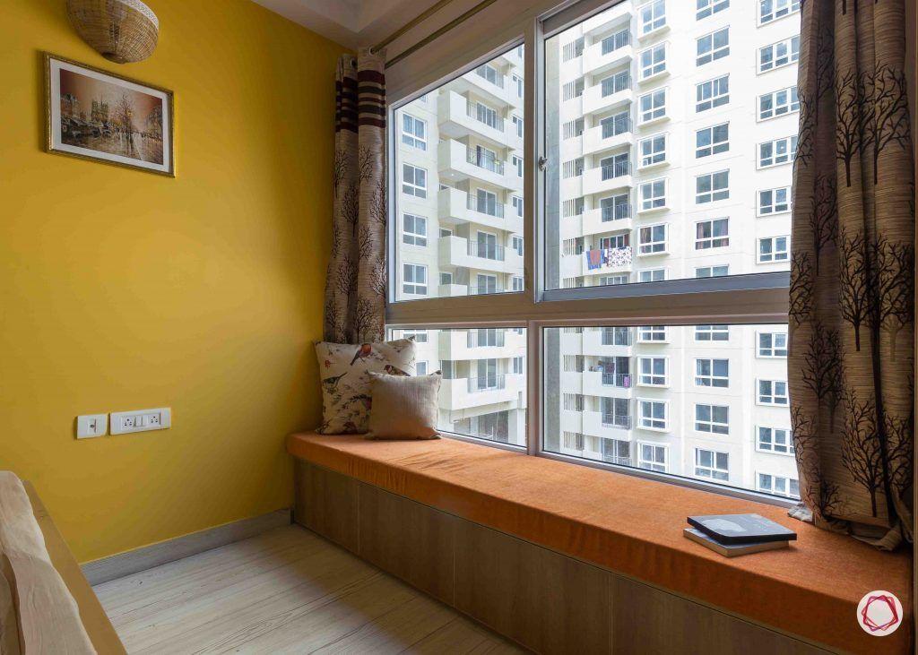 Best interior designers in bangalore_window-seat-yellow-wall