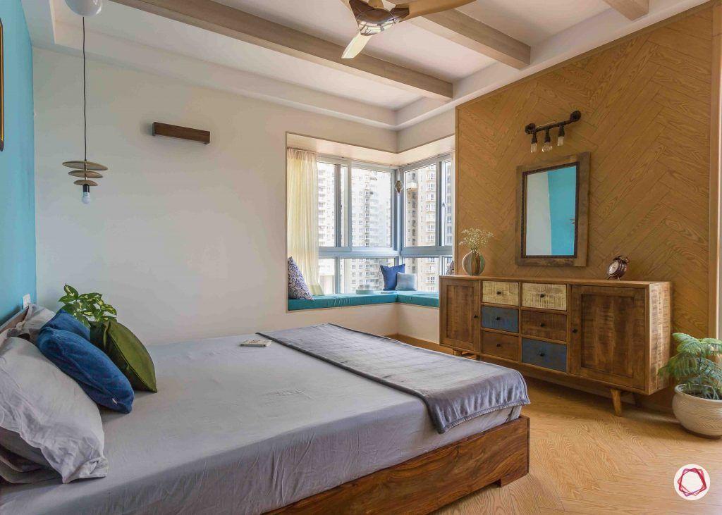 master bedroom-wallpaper-cabinet-mirror-bed-pillows