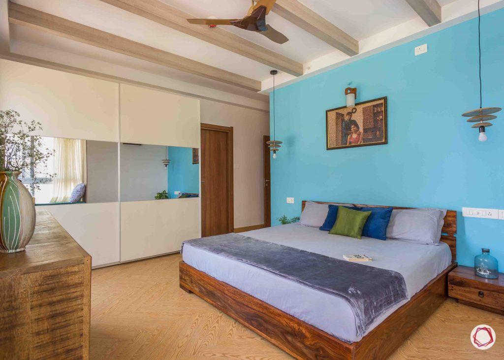 master bedroom-blue-wall-wardrobe-sliding-mirror-panel-rafters