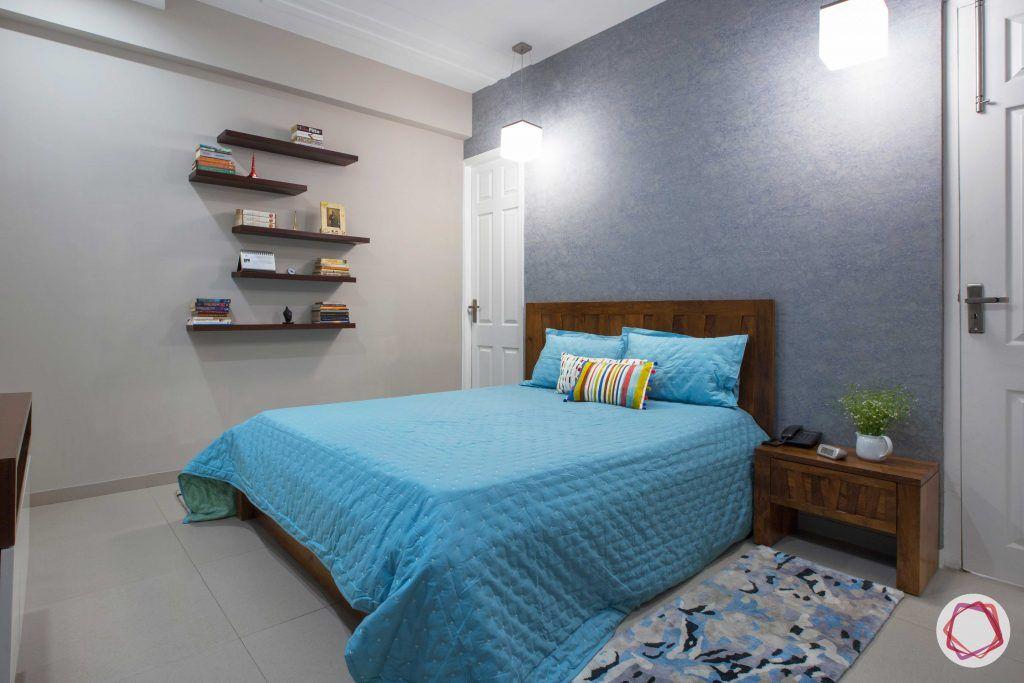 Prateek Stylome-blue wall paint ideas-wooden shelves designs
