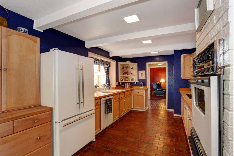 brick-floor-kitchen-fridge-wooden-cabinets