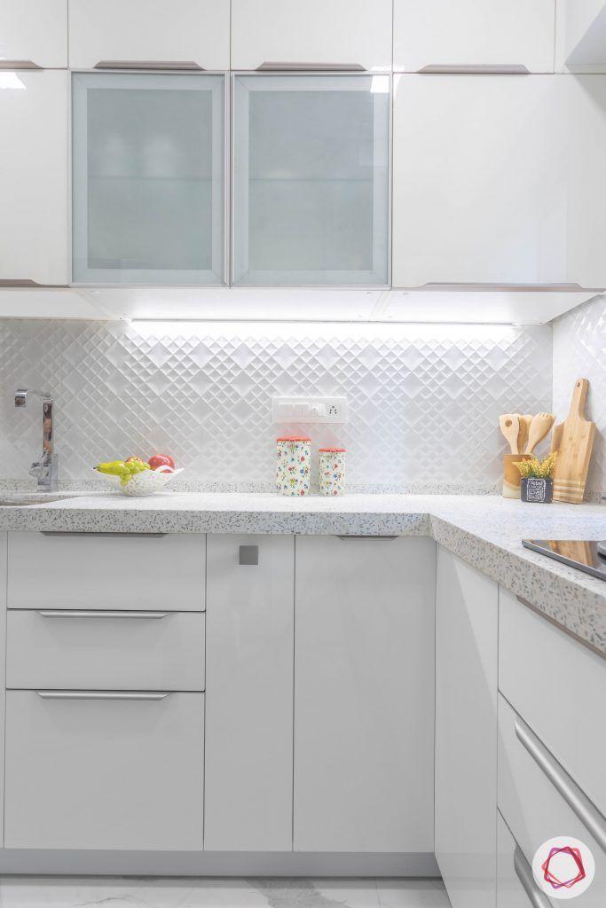 small house plans-white kitchen-frosted glass shutters-white backsplash
