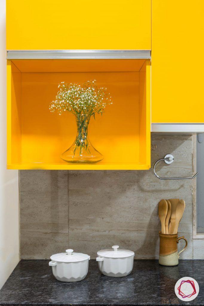 Oberoi esquire_kitchen pop yellow cabinets