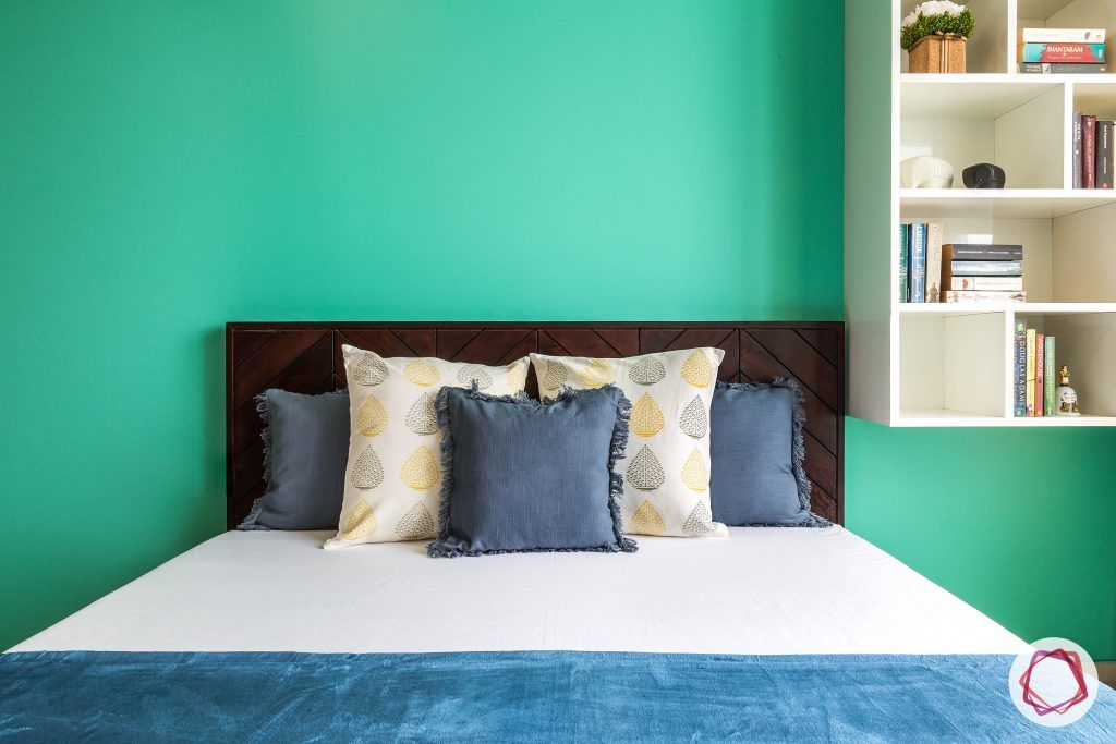 Oberoi esquire_daughters bed and teal wall