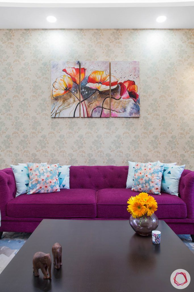 Cleo county noida_purple colour sofa and printed wallpaper