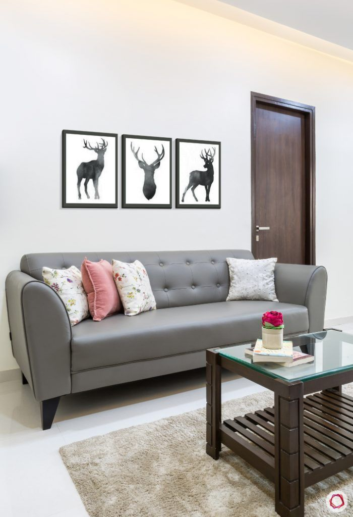 livspacehomes-low budget house-living room-grey sofa-glass coffee table