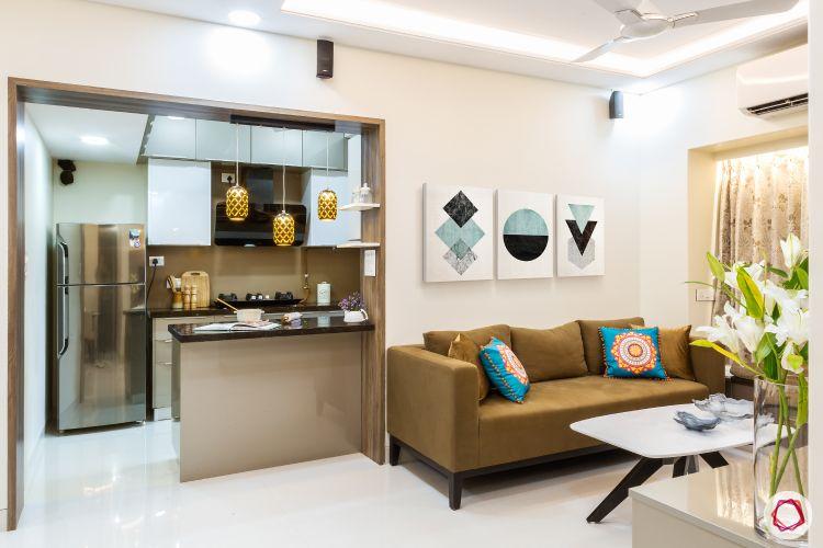 livspacehomes-low budget house-living room-kitchen-pendant lights-beige sofa-false ceiling