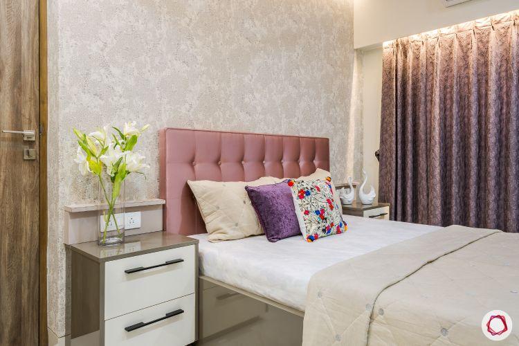 livspacehomes-low budget house-daughters bedroom-subtle wallpaper-pink headboard-bedside tables