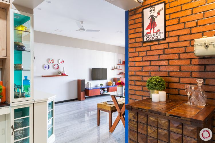 livspacehomes-low budget house-dining room-living-exposed brick wall-crockery unit- tv unit