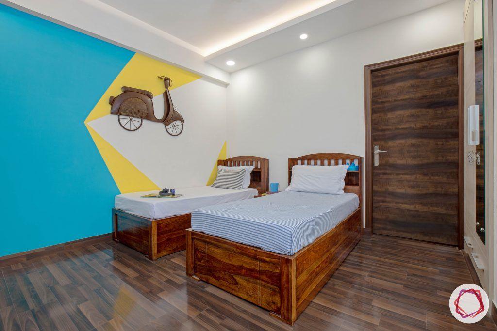 vastu for kids room-wooden-flooring twin-beds wall-art-kids-room