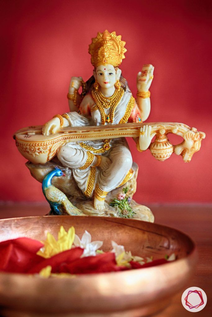 saraswati-idol brass-bowl floral-decoration