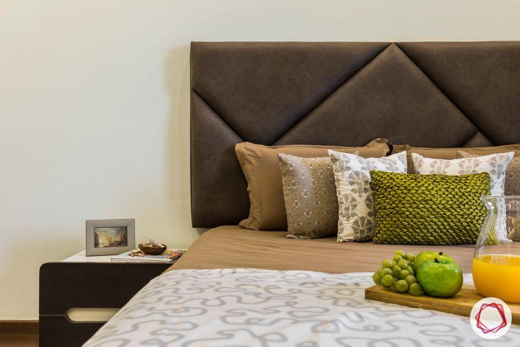 flat interior design-floral master bedroom-headboard-dark grey upholstered headboard