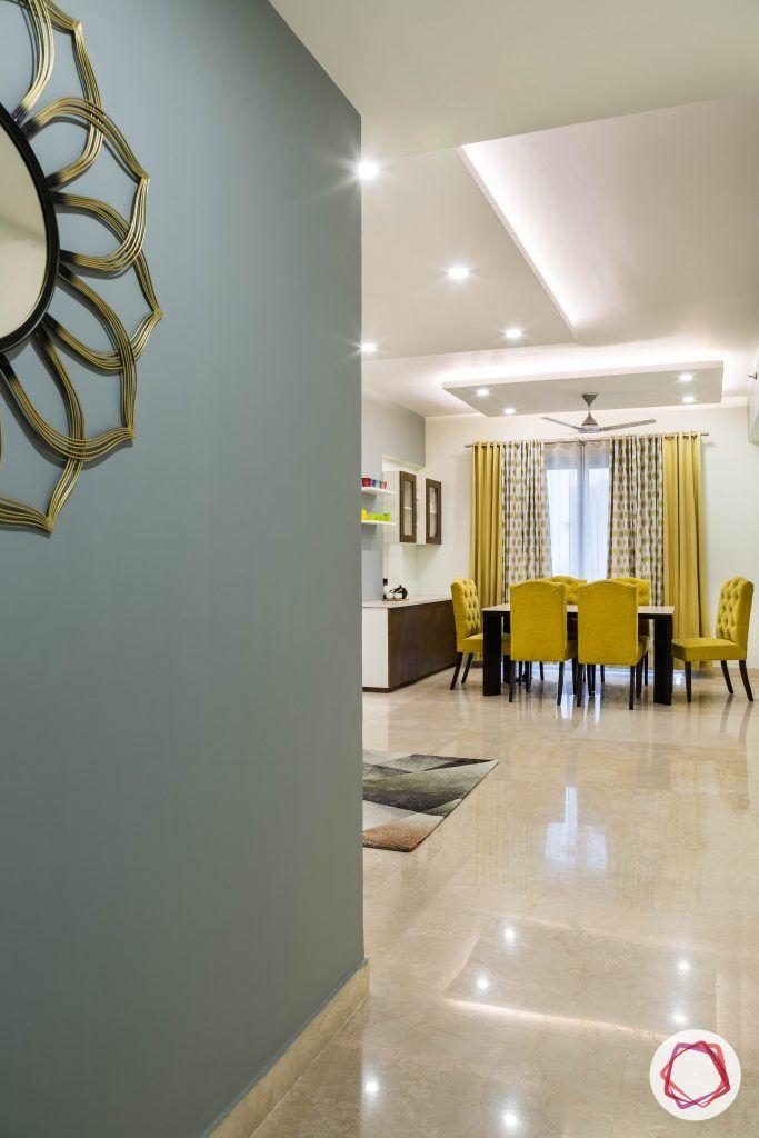 flat interior design-foyer-entrance-modern-blue wallpaper-gold accent-vitrified tiles