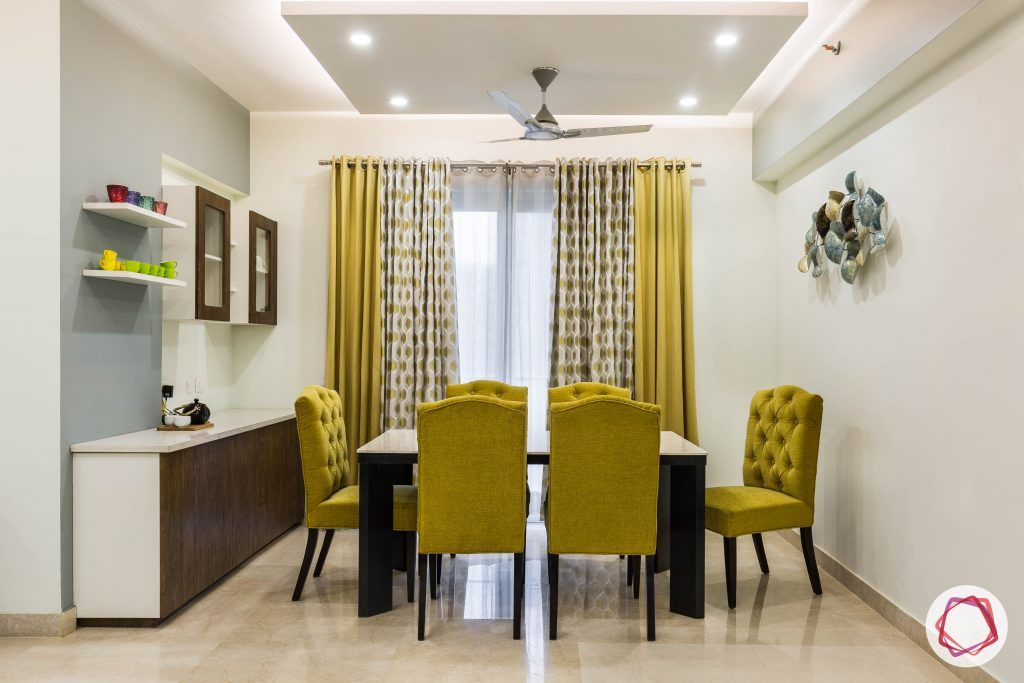 flat interior design-dining room-mustard upholstered chairs-crockery unit-membrane finish
