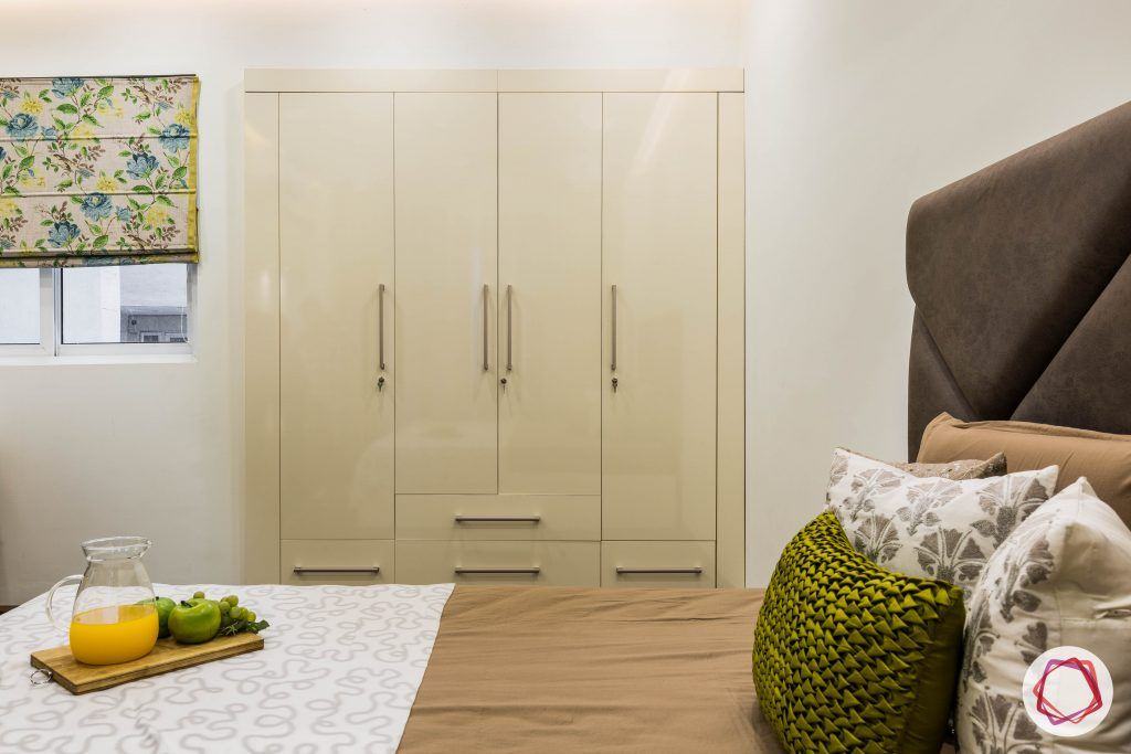 flat interior design-master bedroom-wardrobe-high gloss laminate-drawers-hinged-cupboard