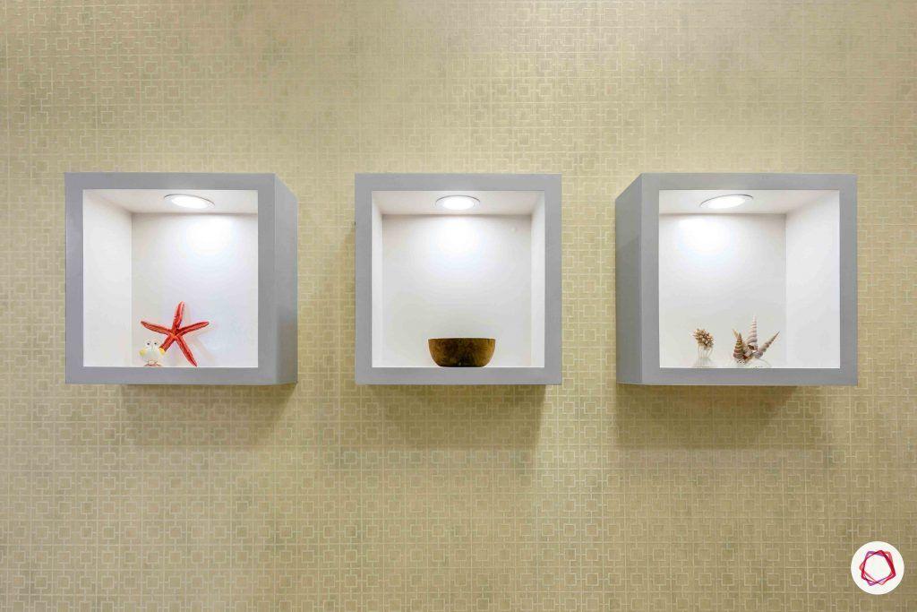 sobha forest view-foyer-display shelves-cove lighting-beige wallpaper