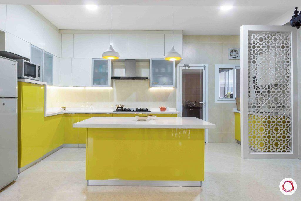 sobha forest view-modular kitchen design-breakfast counter-open kitchen-yellow cabinets-pendant lights
