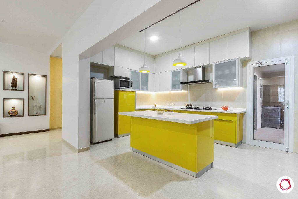 sobha forest view-modular kitchen design-open kitchen-breakfast counter-yellow kitchen cabinets