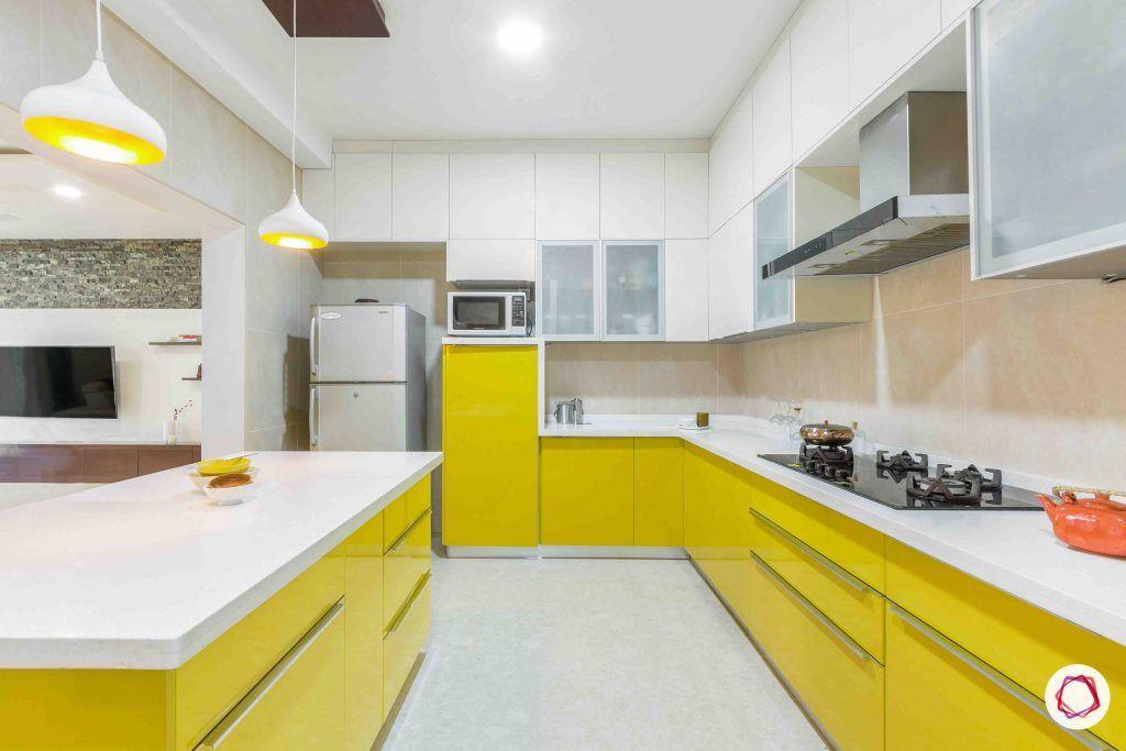 sobha forest view-modular kitchen design-yellow cabinets-lofts-breakfast counter-pendant lights