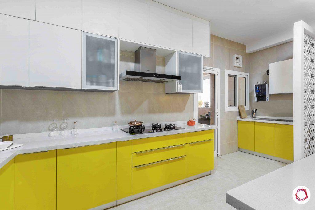 sobha forest view-modular kitchen design-quartz countertop-lofts-yellow base units-hob unit