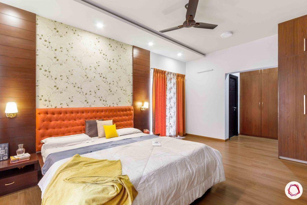 sobha forest view-master bedroom-rust orange-wooden tones-wooden flooring
