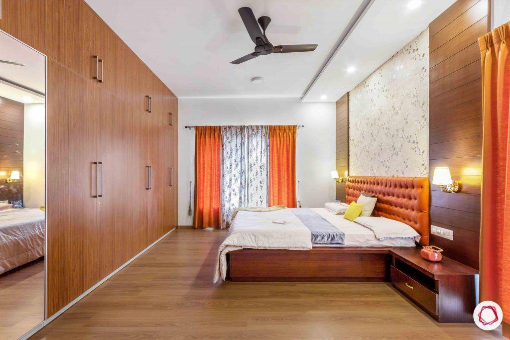 sobha forest view-master bedroom-rust orange-wooden tones-floral wallpaper