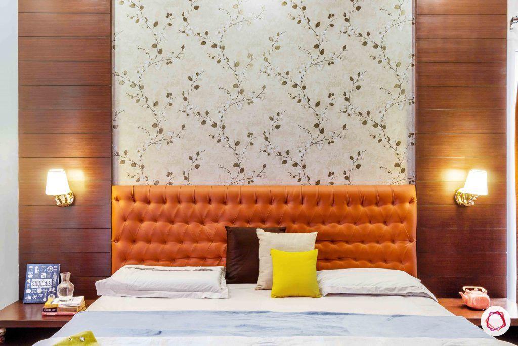 sobha forest view-master bedroom-rust orange-wooden tones-floral wallpaper-veneer panelling
