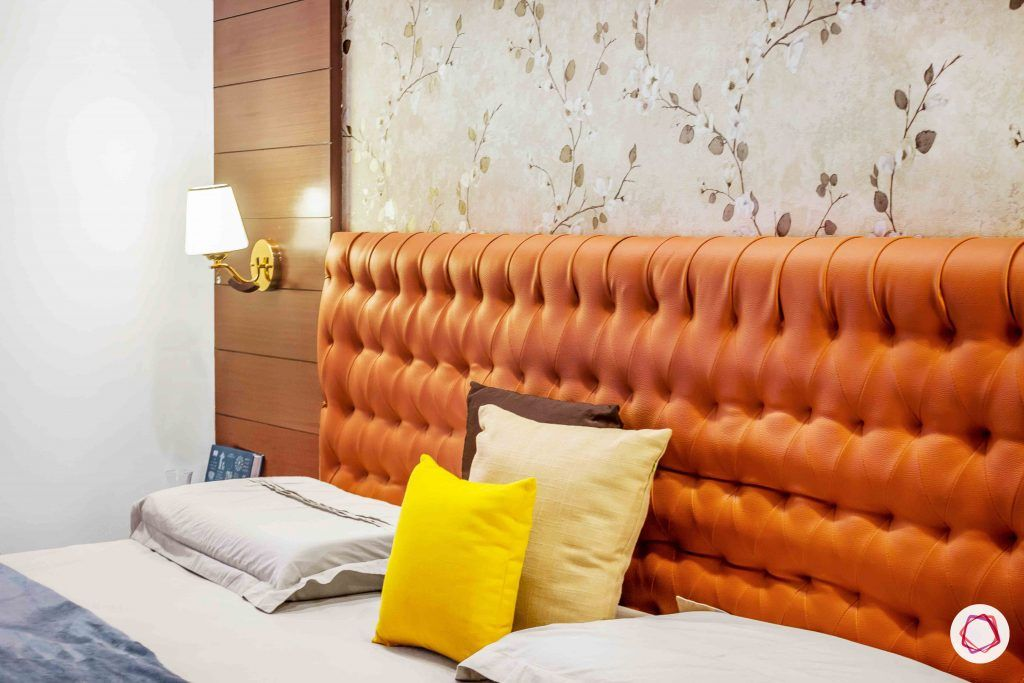 sobha forest view-master bedroom-rust orange-wooden tones-floral wallpaper-headboard