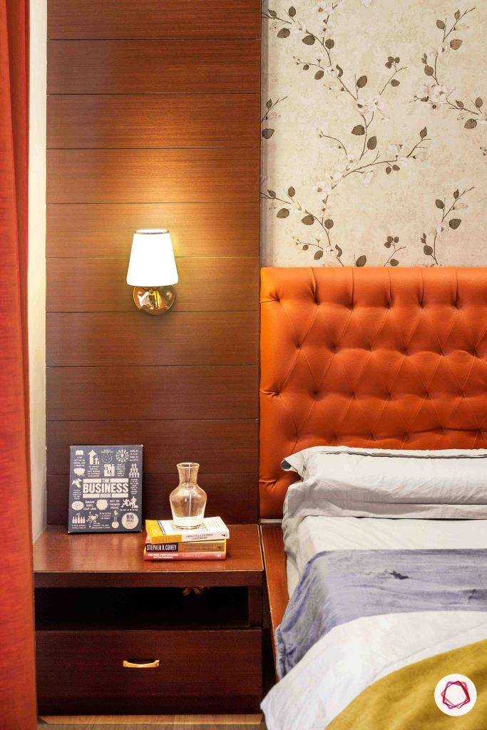 sobha forest view-master bedroom-rust orange-wooden tones-floral wallpaper-veneer panel-lampshade