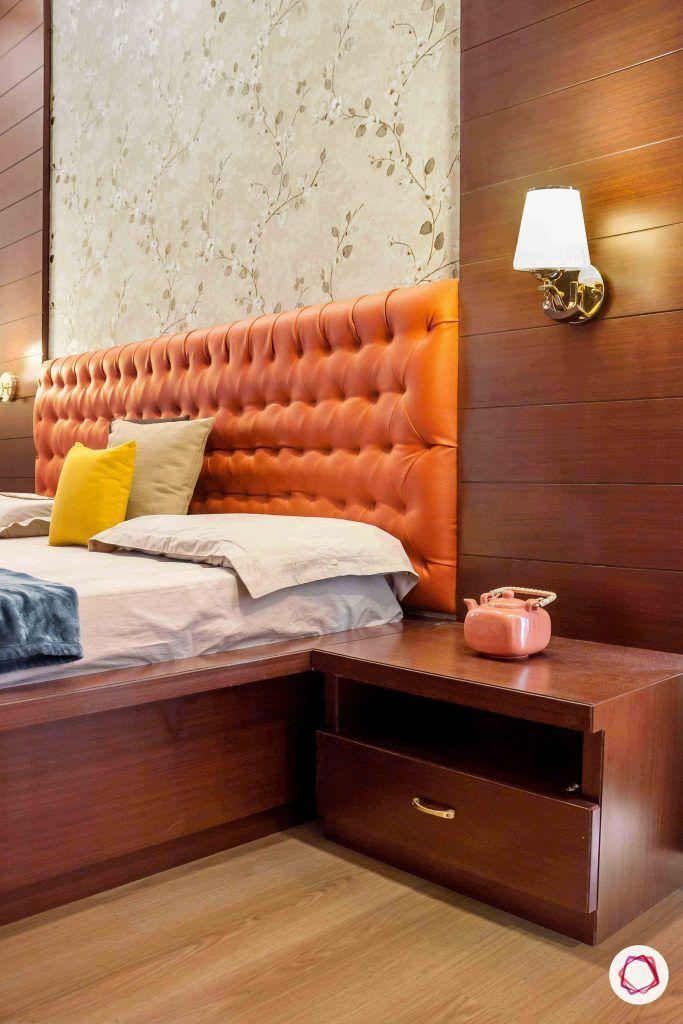 sobha forest view-master bedroom-rust orange-wooden tones-floral wallpaper-headboard-sidetable