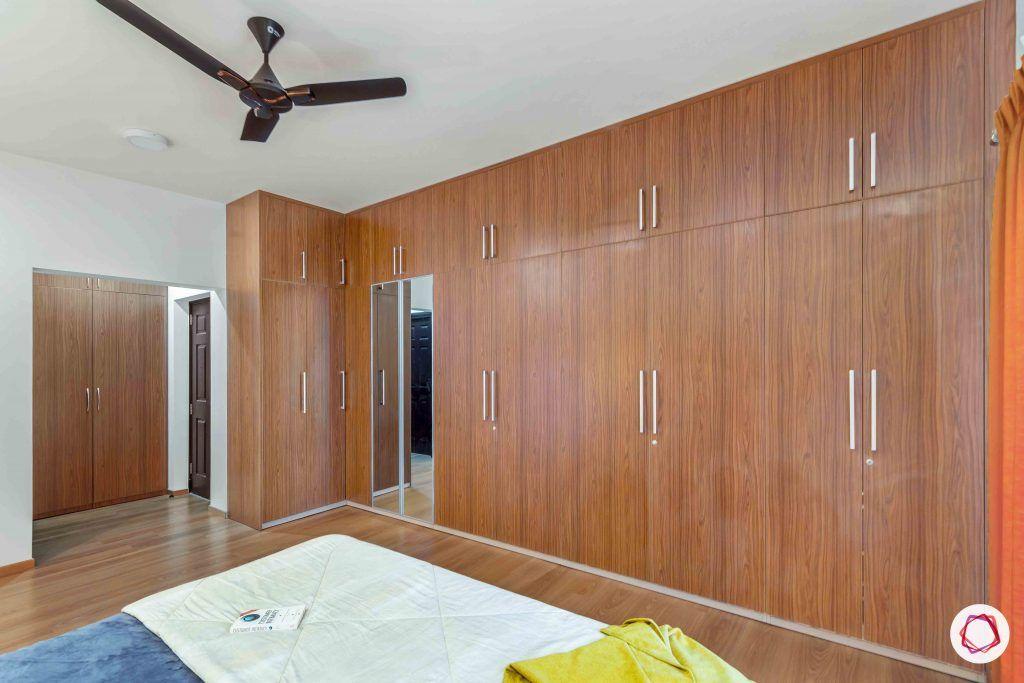 sobha forest view-master bedroom-wooden tones-swing door wardrobes