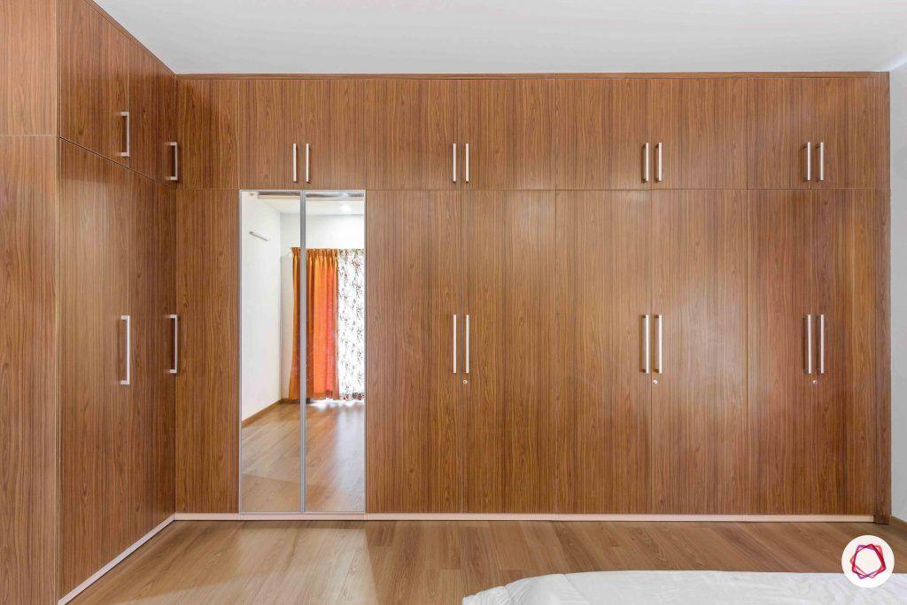 sobha forest view-master bedroom-wooden tones-swing door wardrobes-sleek handles