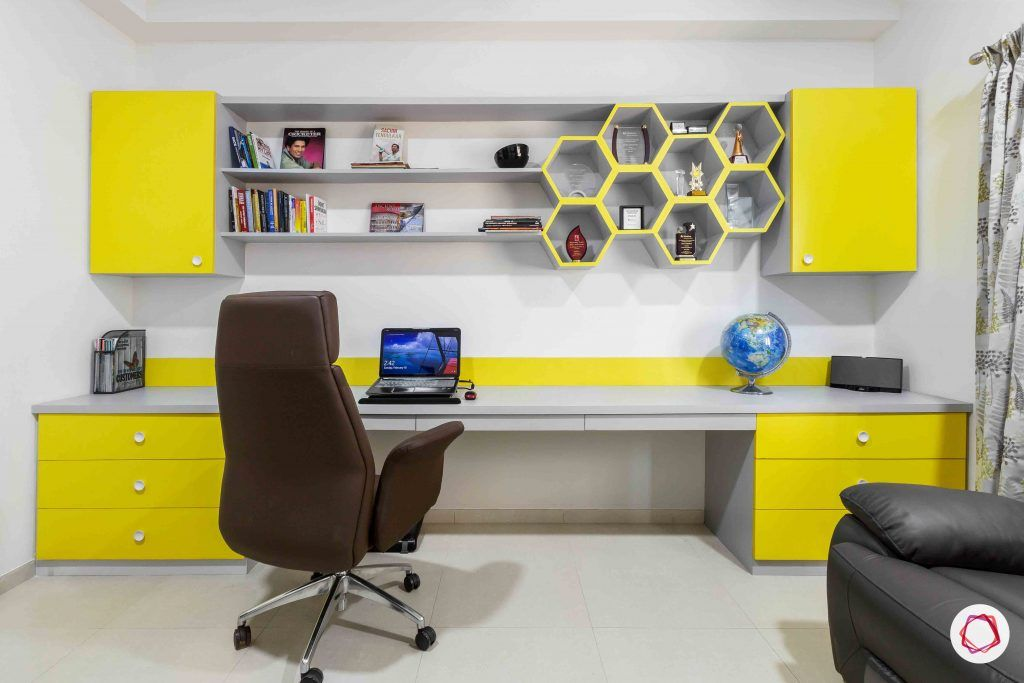 sobha forest view-study room-big study table-wall cabinets-yellow colour shelves