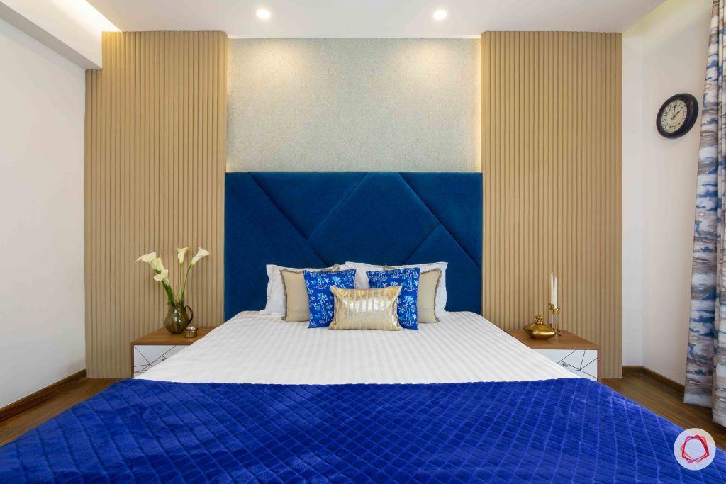 3 bedroom flat design-master bedroom decor-fabric headboard-side table designs-types of wall panelling