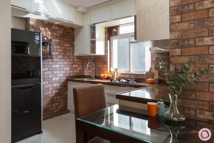 small space interior design-exposed brick wall-kitchen backsplash-2-seater dining table