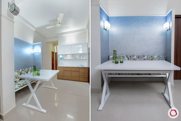 small space interior design-white dining table-bench designs- blue wallpaper