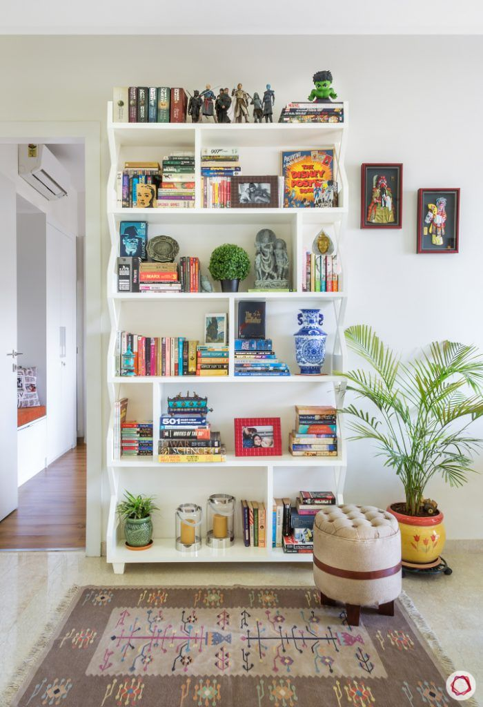 small space interior design-tufted ottoman-rug designs-reading corner-bookshelf designs