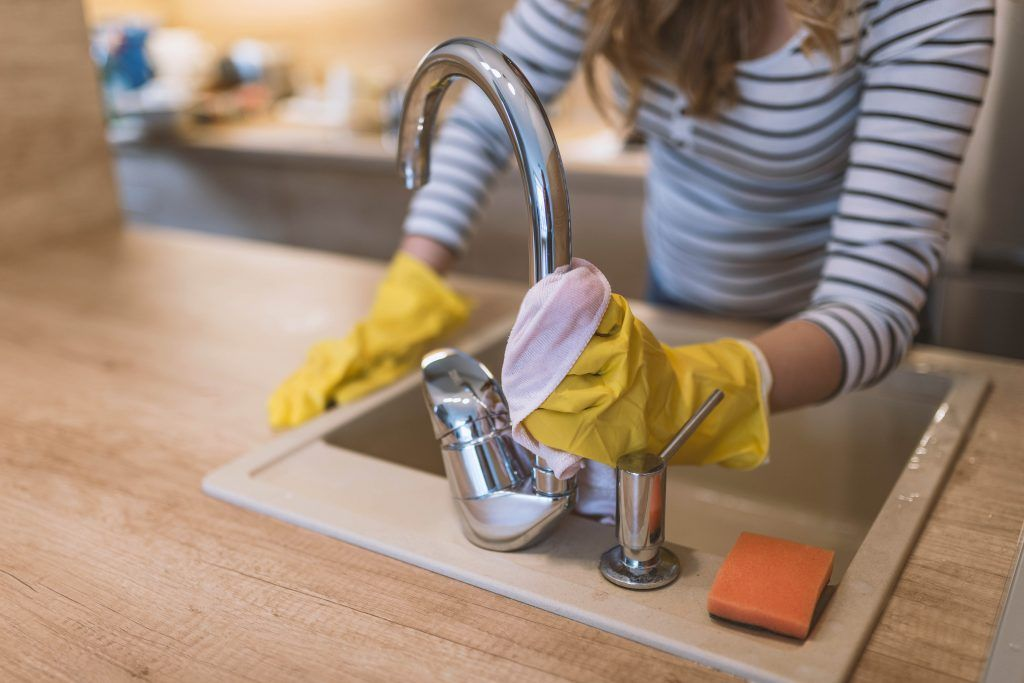 housekeeping-checklist-kitchen-wiping-the-tap-sink-rubber-gloves