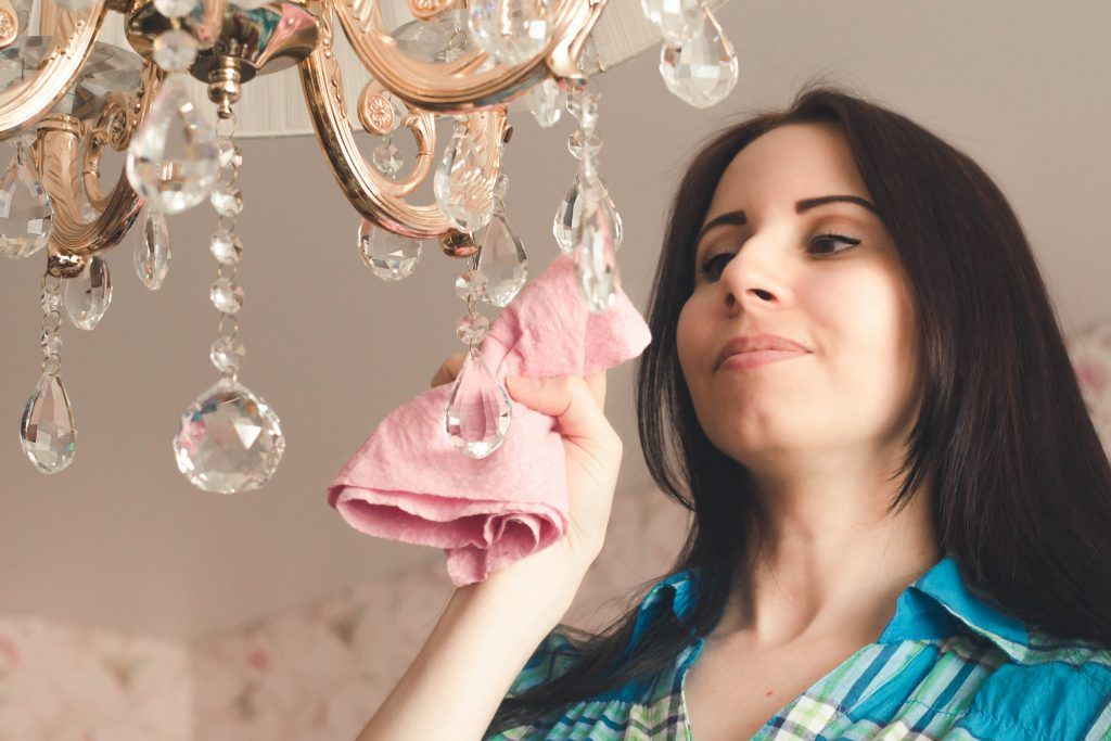 housekeeping-checklist-cleaning-chandelier-light-bulbs-soft-cloth