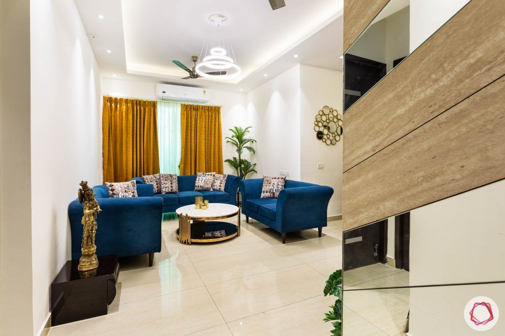 3 bhk flat-home entrance-white ceiling-blue sofa-yellow curtains