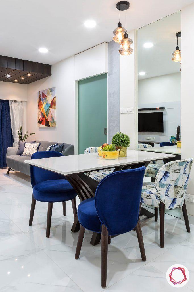 house-renovation-dining-room-stylish-kalinga-top-upholstered-chairs-pendant-lights