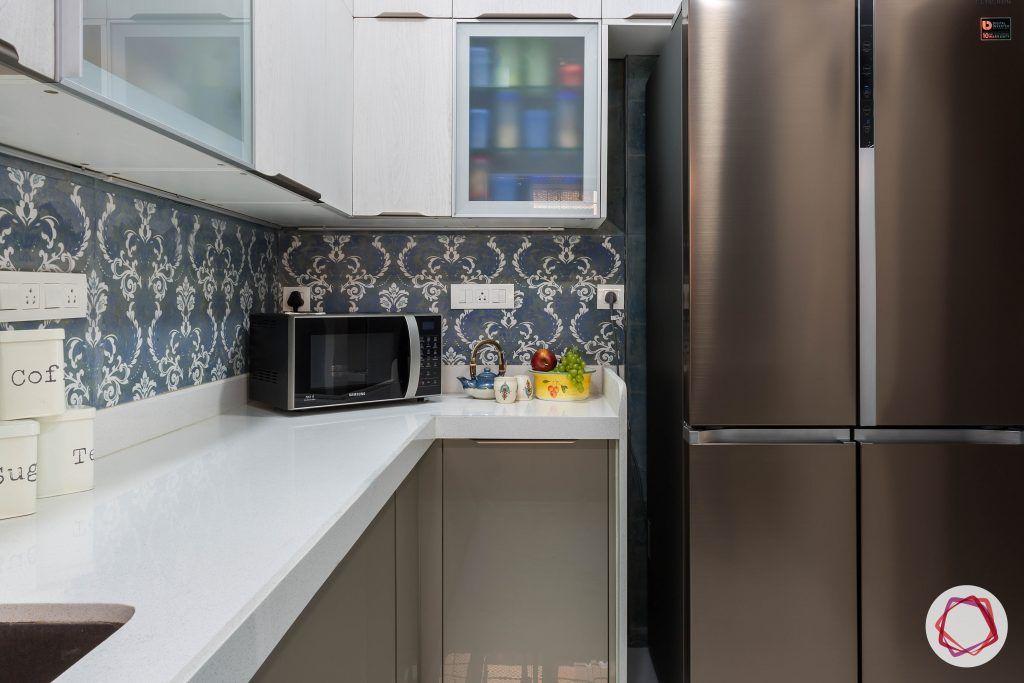 house-renovation-kitchen-cabinets-fridge-frosted-shutter-backsplash-microwave
