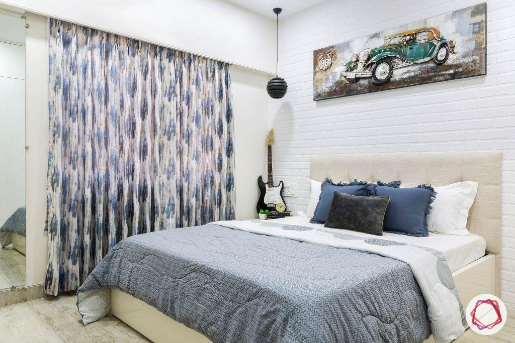 house-renovation-second-bedroom-brick-tiles-bed-beige-headboard-mirror-curtains
