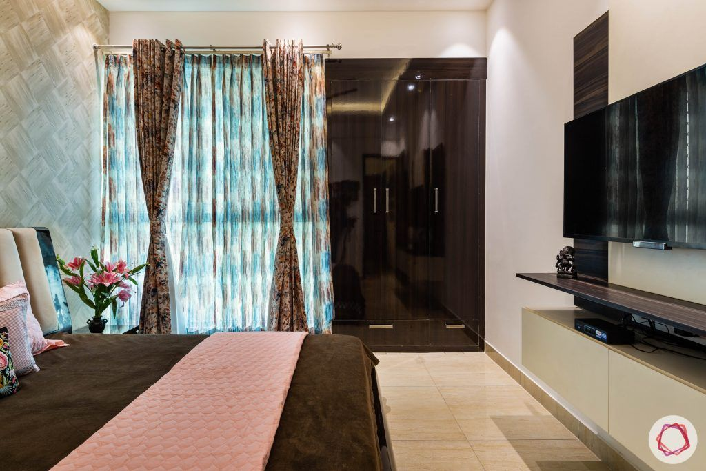 3 bhk flat-bedroom-wardrobes-printed curtains