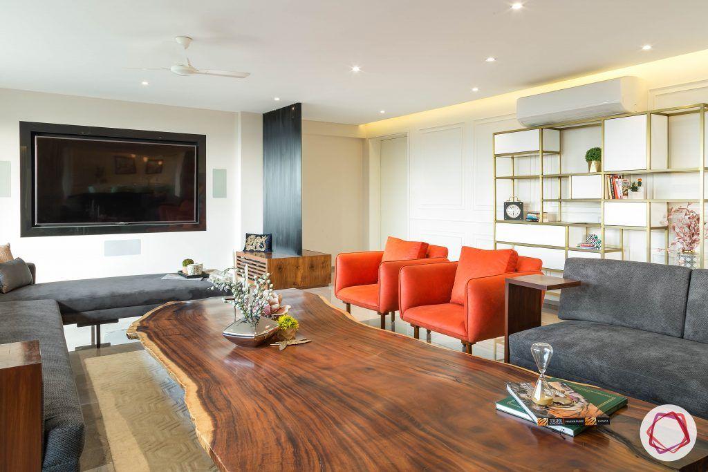 4bhk house plan-l-shaped sofa-orange armchairs-sofa designs-grey sofa-living room furniture-simple media wall
