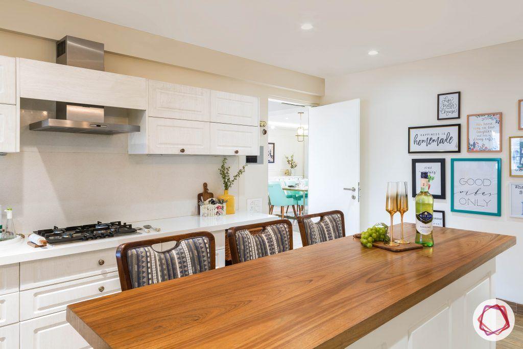 4bhk house plan-white kitchen designs-quartz countertops-white countertops-island kitchen designs-breakfast counter in kitchen-wooden breakfast counter-kitchen island counter